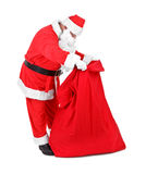 Santa Claus is looking for gifts Royalty Free Stock Photos