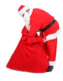 Santa Claus is looking for gifts Royalty Free Stock Photo