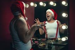 Santa Claus next to the mirror stock photos