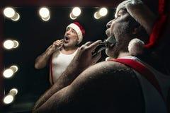 Santa Claus trimmng himself royalty free stock photos
