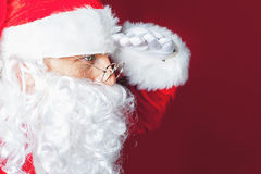 Santa Claus looking for something Stock Image