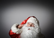 Santa Claus is looking up Stock Photos
