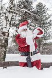 Santa Claus looking on watch. Santa Claus outdoor looking on his watch Royalty Free Stock Images