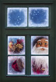 Santa Claus looking through a  window Royalty Free Stock Photo