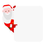 Santa Claus looks out of behind the wall Stock Photos