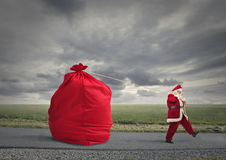 Santa Claus with a lot of presents Royalty Free Stock Photos