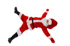 Santa Claus is lying with a bag of gifts. Isolated on white Royalty Free Stock Photos