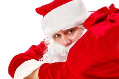 Santa Claus is lying with a bag of gifts. On white Stock Photo