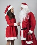 Santa Claus machen ein Abkommen mit Elfe Lizenzfreie Stockbilder