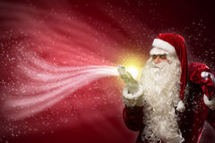 Santa Claus and the magic Stock Photos