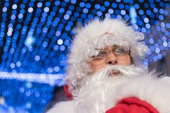 Santa Claus Magic Christmas Lights In Night. Santa Claus Stock Photo