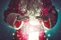 Santa Claus with magic Christmas lights. Christmas concept Stock Image