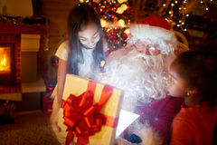 Santa Claus with magic gift Stock Images