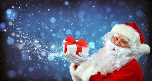 Santa Claus with magic light in his hands royalty free stock photo