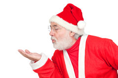 Santa Claus magically blowing Stock Photo