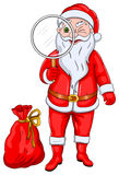 Santa Claus with Magnify Glass Royalty Free Stock Photos