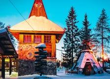 Santa Claus Main Post Office in Santa Village dusk. Rovaniemi, Finland - March 5, 2017: Santa Claus Main Post Office in Santa Village at dusk. Lapland, Finland royalty free stock photos