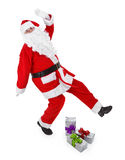Santa claus makes funny pose. Funny pose of santa claus on white background Royalty Free Stock Images