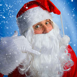 Santa Claus makes a motioned to you to call him. Charismatic Santa Claus makes a motioned to you to call him royalty free stock images
