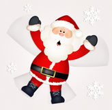 Santa Claus makes snow angel Royalty Free Stock Images