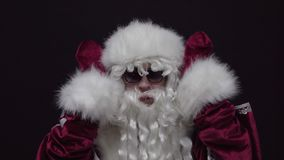 Santa Claus making funny face on the camera. stock video footage