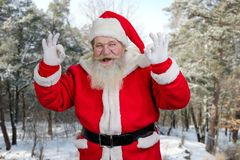 Santa Claus making ok sign with both hands. Stock Photos
