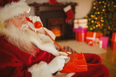 Santa claus making a phone call Royalty Free Stock Images