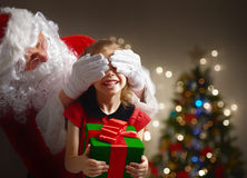 Santa Claus. Making a surprise for little girl royalty free stock photography