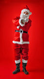 Santa Claus making umbrella Italian gesture. Royalty Free Stock Images