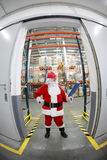 Santa claus manager in storehouse Stock Photo