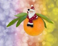 Santa Claus on mandarin Royalty Free Stock Photography