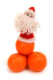 Santa Claus on mandarins Royalty Free Stock Photo