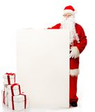 Santa Claus with many gift boxes Royalty Free Stock Image