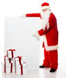Santa Claus with many gift boxes Royalty Free Stock Photography