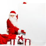 Santa Claus with many gift boxes Stock Images