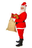 Santa Claus with many presents Royalty Free Stock Photo
