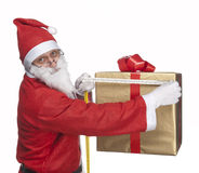 Santa Claus measuring a gift box Royalty Free Stock Photo