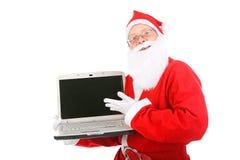 Santa Claus med bärbar dator Arkivfoton