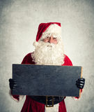 Santa Claus med chalboard Royaltyfri Fotografi