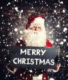 Santa Claus med chalboard Arkivbild
