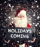 Santa Claus med chalboard Arkivfoto