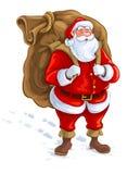 Santa Claus med den stora säcken av gåvor Arkivfoto