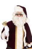 Santa Claus med dollarexponeringsglas Arkivfoto