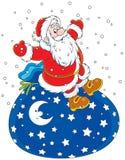 Santa Claus med en gåvapåse Arkivfoton