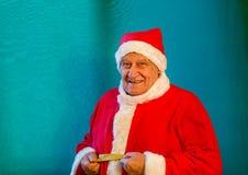 Santa Claus med en måttband royaltyfri foto