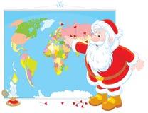 Santa Claus med en världskarta Royaltyfria Bilder
