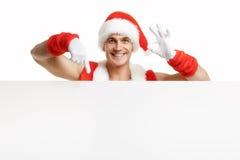 Santa Claus med försäljningar för ett baner Arkivbilder