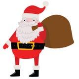 Santa Claus med gåvapåsen. Julbakgrund Royaltyfria Bilder