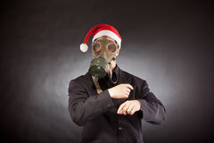 Santa Claus med gasmasken Arkivfoto