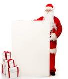 Santa Claus med många gåvaaskar Royaltyfri Bild